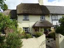 Picturesque thatched listed cottage, set in a tucked away location on the edge of this historic village...